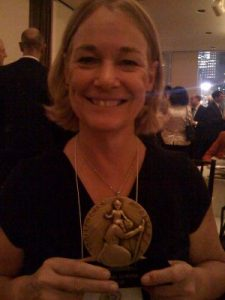 """At the Christopher Awards with my medal for writing Until Our Last Breath"""""""