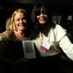 With Catherine delors, showing off her book on my Kindle